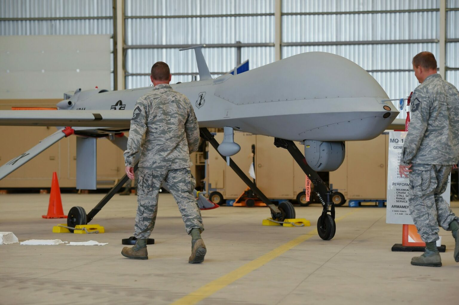 Soldiers pass a US unmanned remotely piloted aircraft MQ-1 Predator during a guest day at Lielvarde airbase, south-east of Riga, Latvia, on 8 September 2015. Latvia had confirmed a week before that two US Army Predator surveillance drones and 70 airmen had deployed to the base for a training mission. The name Predator may have been inspired by the movie featuring Arnold Schwarzenegger.