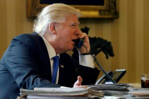 U.S. President Donald Trump speaks by phone with Russia's President Vladimir Putin in the Oval Office at the White House in Washington, U.S. January 28, 2017.
