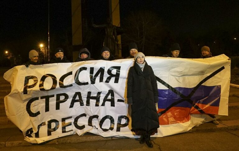 """Ukrainian protesters hold a banner reading """"no blockade of the Azov Sea!"""" During a rally in Mariupol, south coast of Azov sea, eastern Ukraine, Wednesday, Nov. 28, 2018. The Cold War may have restarted from the Russian occupation and annexation of Crimea in 2014."""
