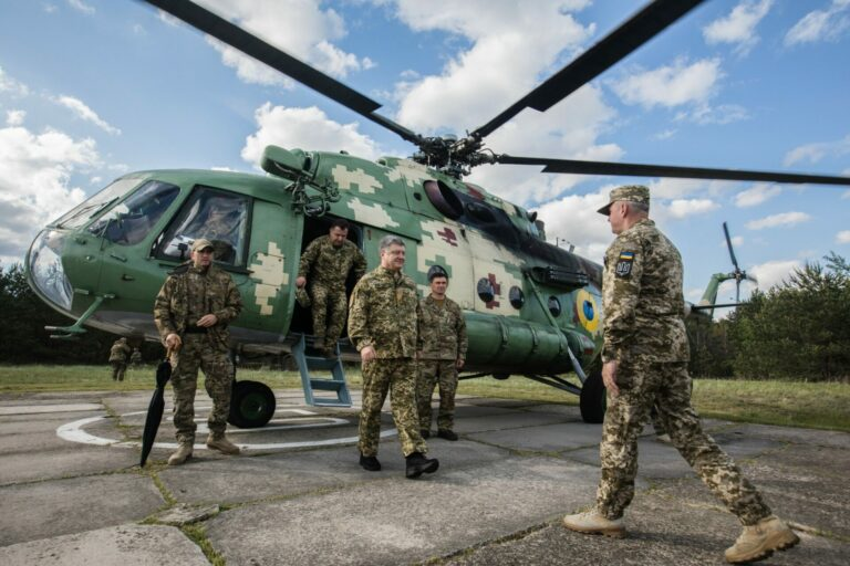Ukraine's President Petro (Pyotr) Poroshenko (C) steps off a helicopter as he arrives to watch US-supplied Javelin antitank missile systems tested by the Ukrainian military at undisclosed testing grounds. Popular support for Poroshenko is not very high.