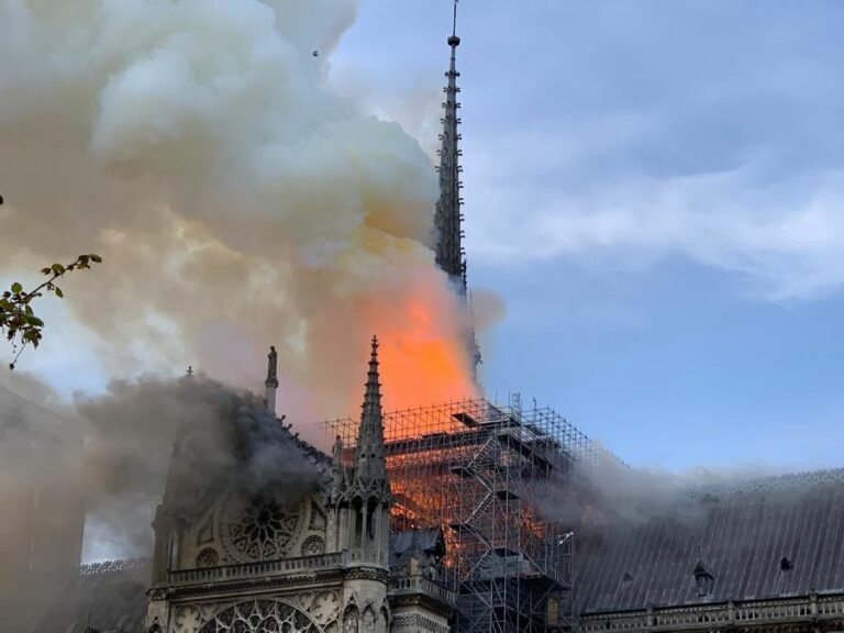 Smoke and flames rise from Notre-Dame cathedral in Paris on 15 April 2019. France's president, Emmanuel Macron, has pledged to restore the cathedral to its former glory.