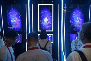 People have their faces scanned as they arrive for the opening ceremony of the World Artificial Intelligence Conference (WAIC) in Shanghai in August 2019. The United States is leading rivals in development and use of artificial intelligence while China is rising quickly and the European Union is lagging.